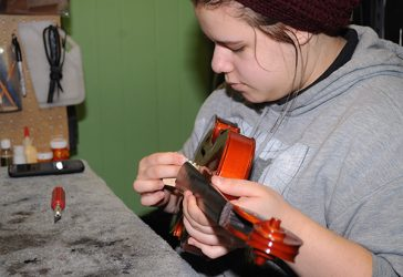 Head apprentice Marissa Pintz with violin